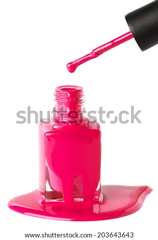 Pink nail polish and brush on white  - stock photo