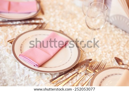 Pink napkin on a plate  - stock photo