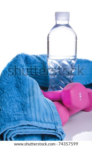 pink one kilogram weights on white with reflection and copy space with water bottle with copy space in the center of bottle and blue sweat towel - stock photo