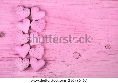 Pink or rose wooden background with hearts for valentine or wedding. - stock photo