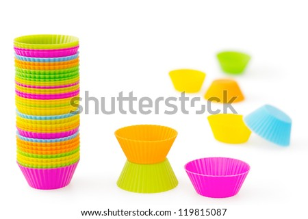 Pink, orange, green, blue and yellow silicone baking cups for muffins or cupcakes - stock photo