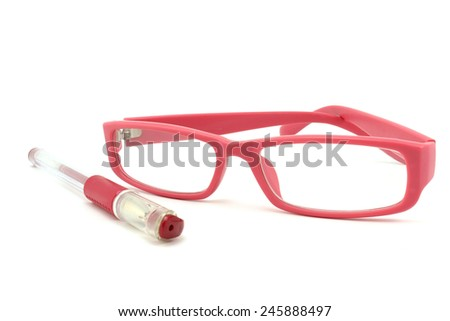 Pink pen and glasses in a pink frame - stock photo
