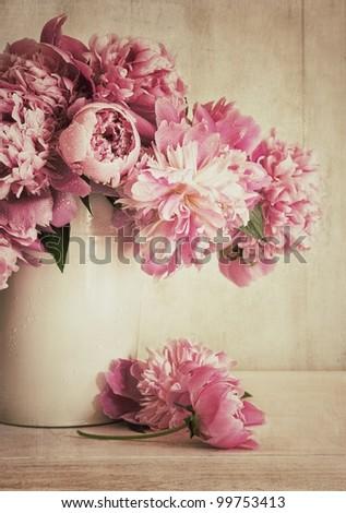 Pink peonies in vase with vintage look - stock photo