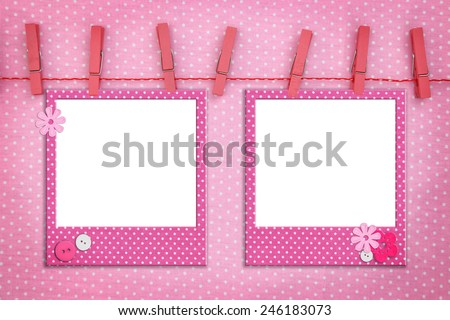 Pink photo frames hanging on a rope - stock photo
