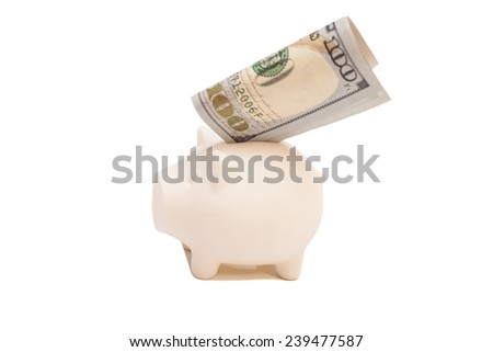 Pink piggy bank and one hundred dollar bill, isolated on white background  - stock photo