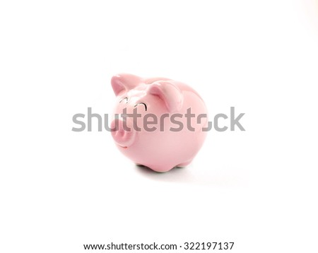 Pink piggy bank on white background - stock photo