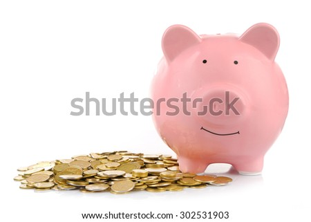 Pink piggy bank with coins isolated on white - stock photo
