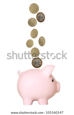 Pink piggy bank, with euro coins falling into slot. Isolated - stock photo