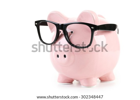 Pink piggy bank with glasses isolated on a white - stock photo