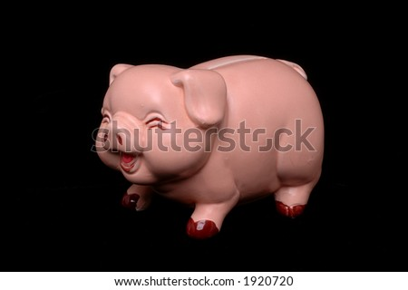 Pink piggy bank with laughing express on black background - stock photo
