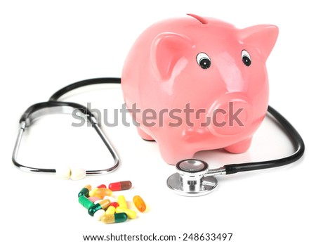 Pink piggy bank with stethoscope isolated on white - stock photo