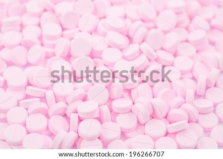 Pink pills  - stock photo