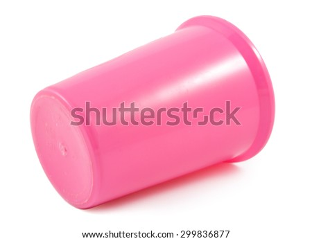 pink plastic glass on a white background - stock photo