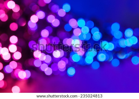 Pink, purple and blue defocus lights abstract background. - stock photo