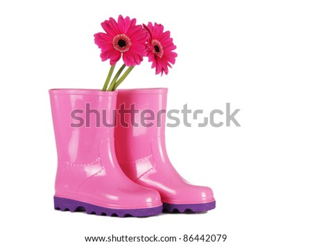 Pink rain boots with daisies - stock photo