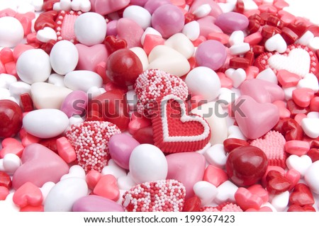 Pink, red, and white candies - stock photo