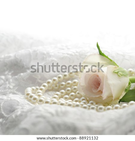 Pink rose with pearls - stock photo