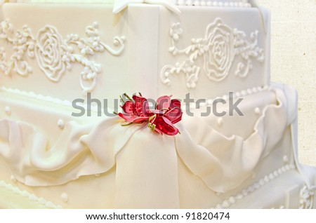 pink roses on wedding cake - stock photo