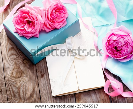 pink roses on wooden background in vintage style - stock photo