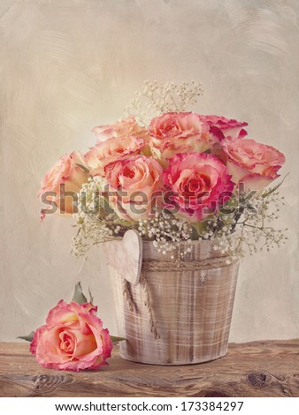 Pink roses on wooden desk - stock photo