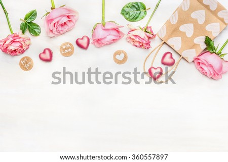 Pink roses with chocolate heart, shopping bag and round sign with message for you and with love on light background, top view.  Valentine Day or Birthday greeting card. Border. - stock photo