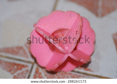 Pink rubber toy for a dog isolated on floor - stock photo