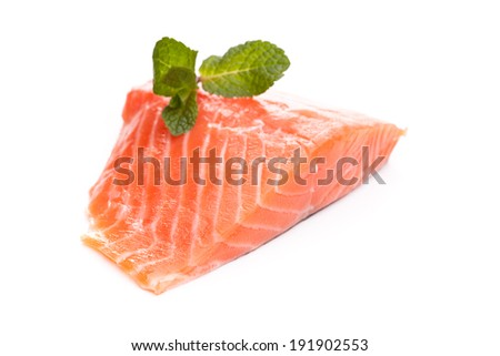 Pink salmon fillet with mint leaves as a garnish - stock photo