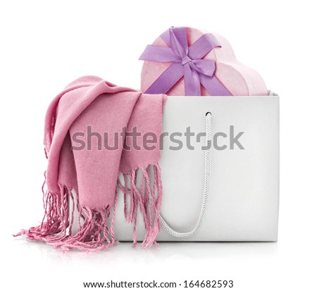 Pink scarf in shopping bag with gift box isolated on a white background - stock photo