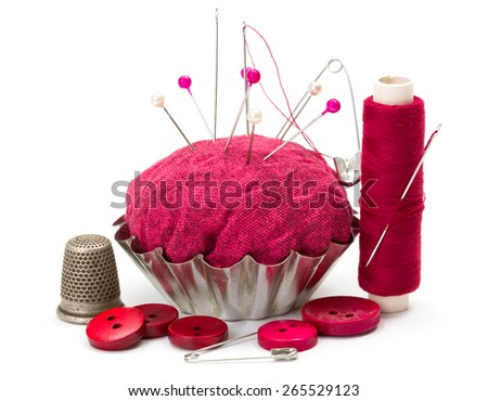 Pink sewing accessories: thread, needle, buttons, thimble and pincushion - stock photo