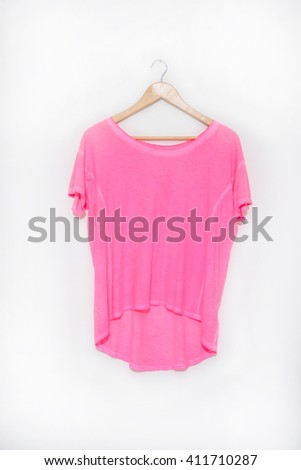 Pink shirt on wooden hangers  - stock photo