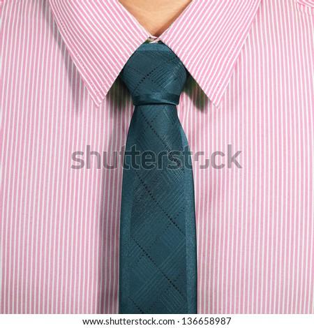 pink shirt with dark blue necktie - stock photo