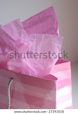 Pink shopping bag with tissue paper - stock photo