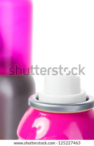 Pink shot of spray can isolated on white with cap - stock photo