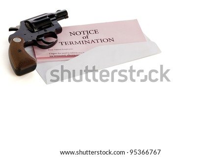 Pink slip termination notice lies on white background with a gun lying on top of it - stock photo