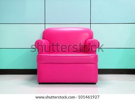 Pink sofa and modern wall - stock photo