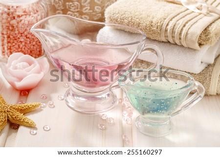 Pink spa set: liquid soap, essential oils, towels and sea salts - stock photo