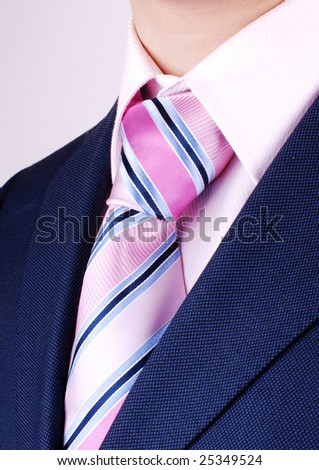 Pink stripped tie on mens neck - stock photo