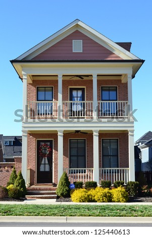 Pink Suburban American New England Style Dream Home with Large Front Porch - stock photo