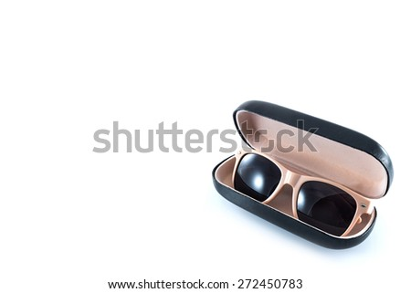 pink sunglasses in pink opened case on white background  - stock photo