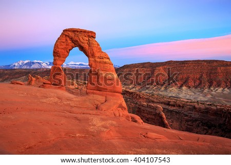 Pink sunset at Delicate Arch, Utah, USA. - stock photo