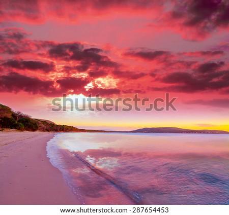 pink sunset in Mugoni beach, Sardinia - stock photo