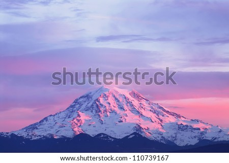 Pink sunset light on Mount Rainier in the Cascade Range, Washington State, USA - stock photo