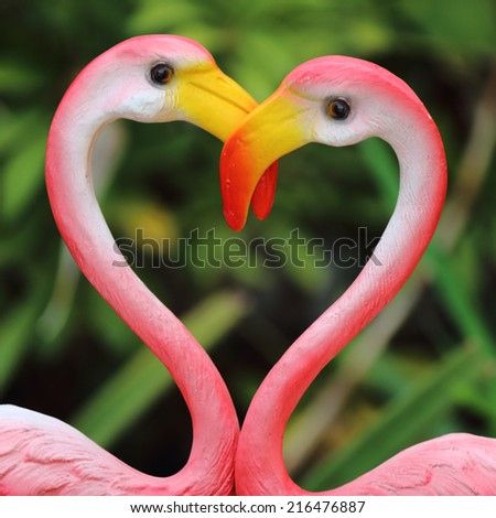 Pink swan love heart sign - stock photo
