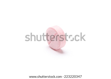 Pink tablet, isolated on white. Healthcare concept. - stock photo