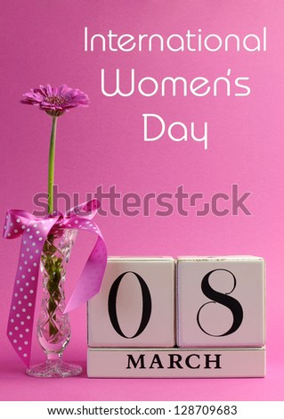 Pink theme, save the date white block calendar for International Women's Day, March 8, decorated with flower, vase and polka dot ribbon. Vertical with title message. - stock photo