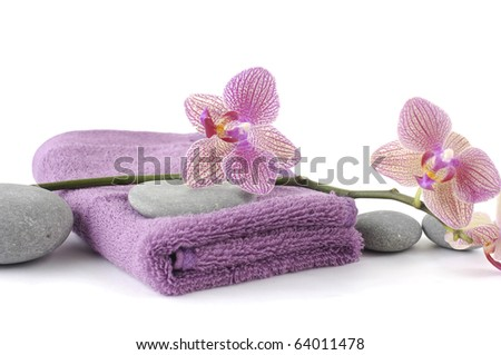 Pink towel for body care (SPA concept) - stock photo