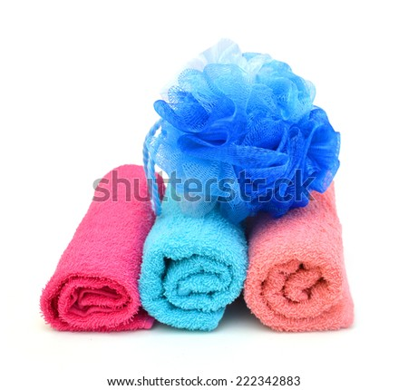 Pink towels and blue bath puff  - stock photo