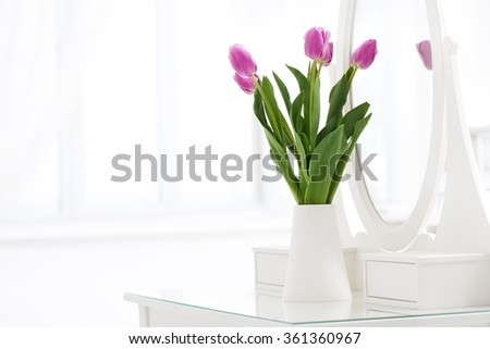 pink tulip in white room - stock photo