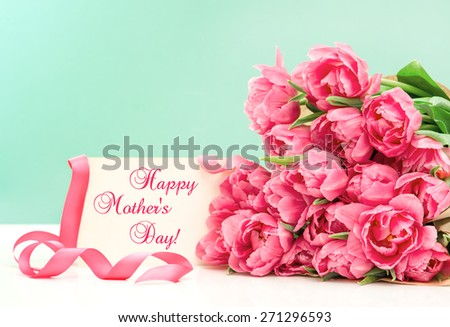 Pink tulips and greeting card with sample text Happy Mothers Day! - stock photo