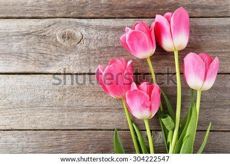 Pink tulips on grey wooden background - stock photo